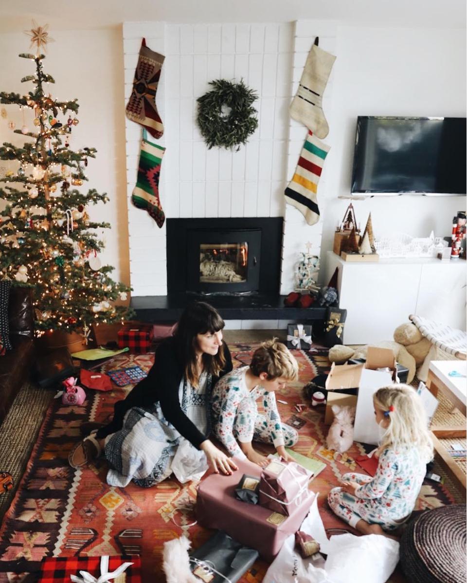 fireplace with kilim stockings and Christmas tree