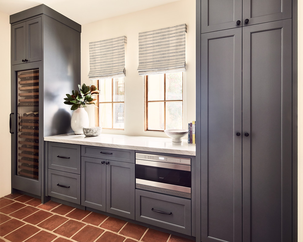 butlers' pantry with dark gray cabinets