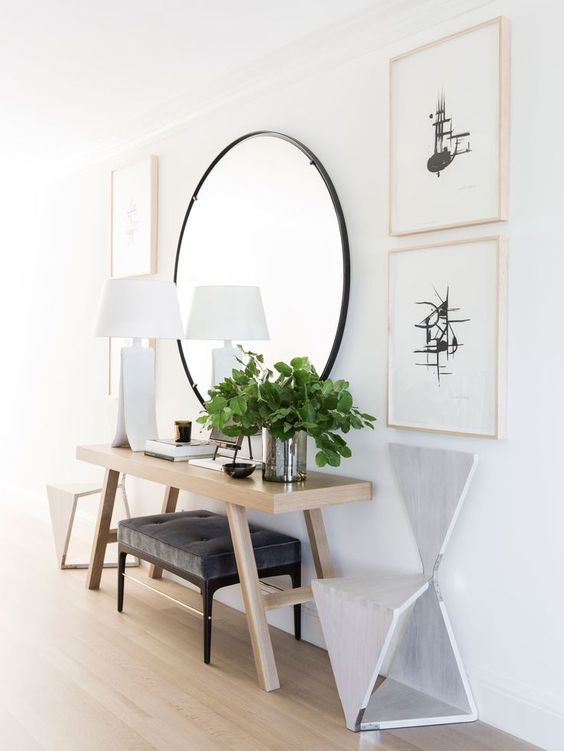 chic-contemporary-entryway-with-console-table-and-black-round-mirror