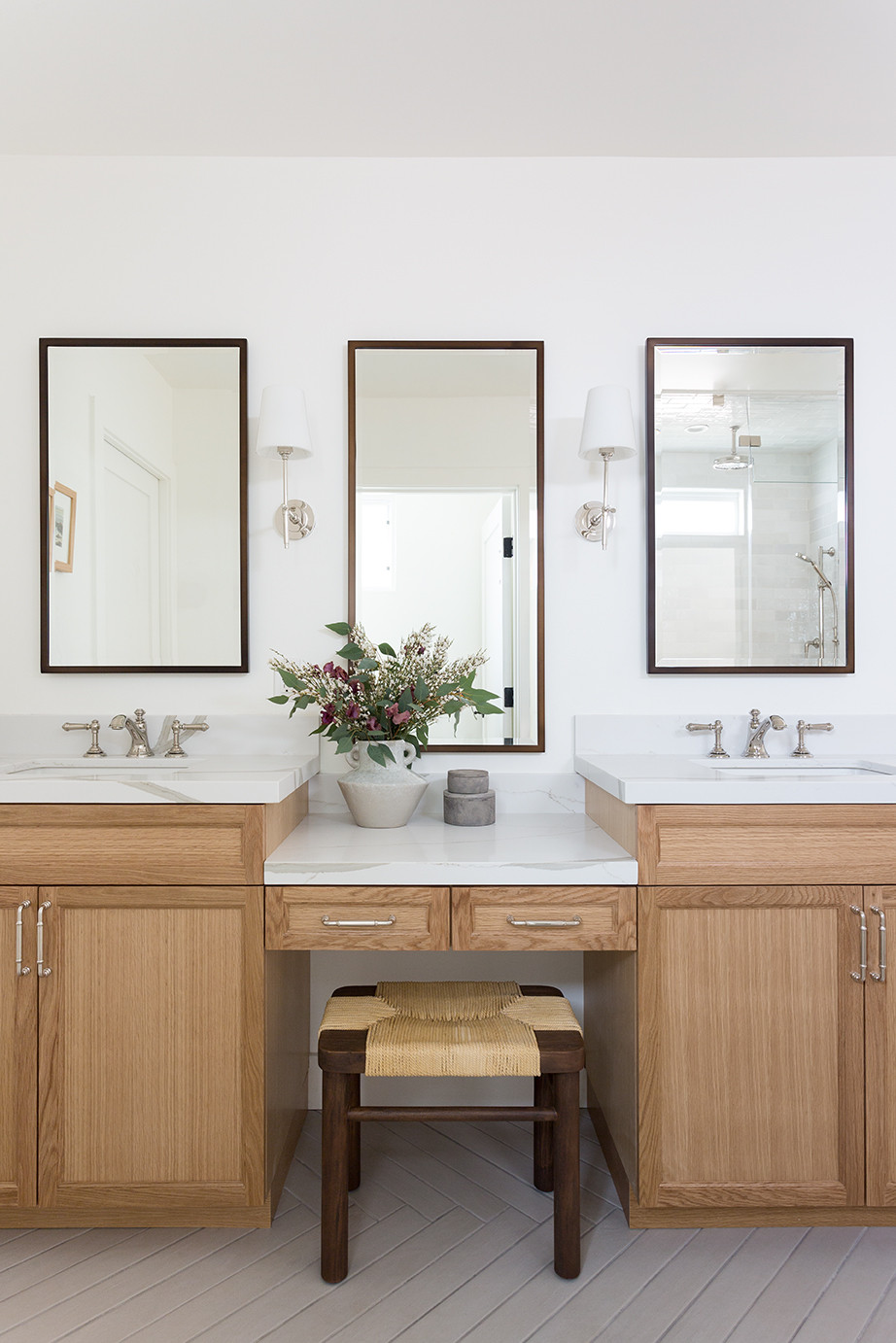 bathroom with oak cabinets and Quartz counters by Lindsey Brooke Design