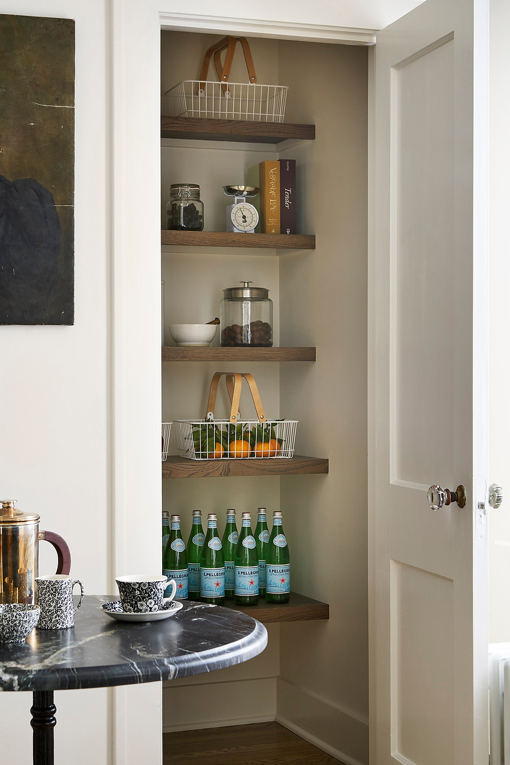 small pantry with wood shelves