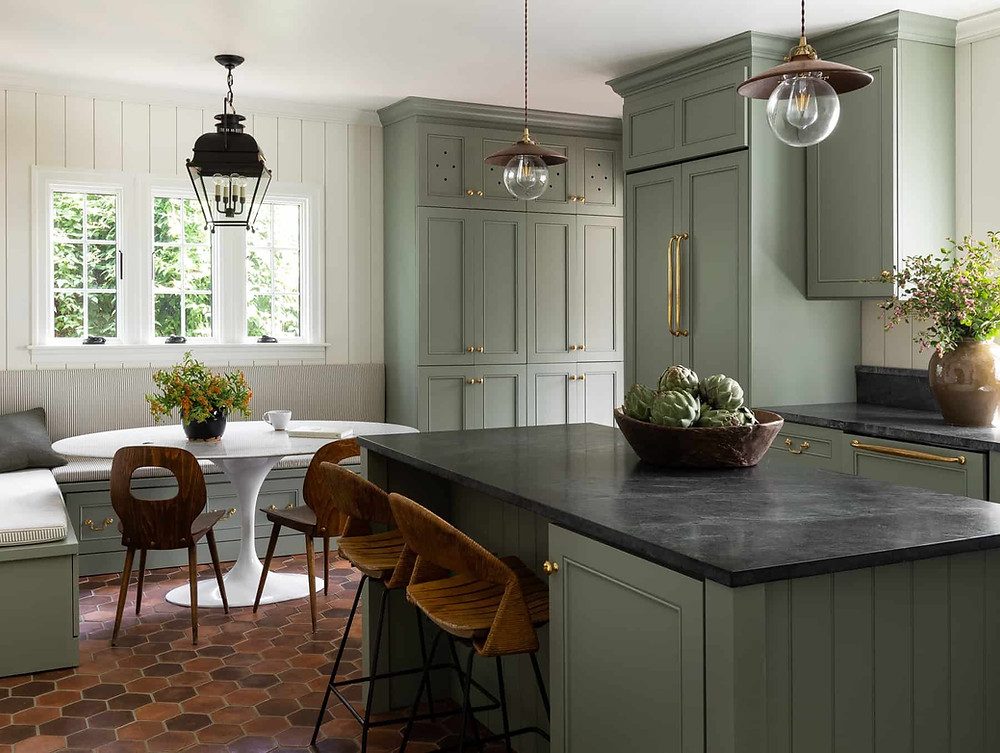 kitchen with green cabinets and dining nook