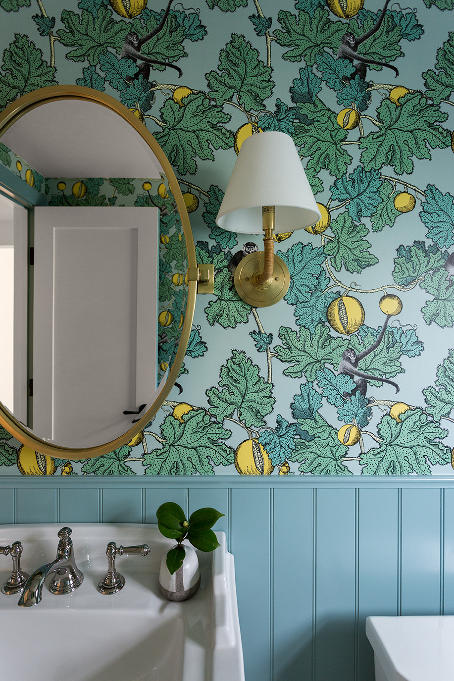 powder room with wallpaper by Lindsey Brooke Design