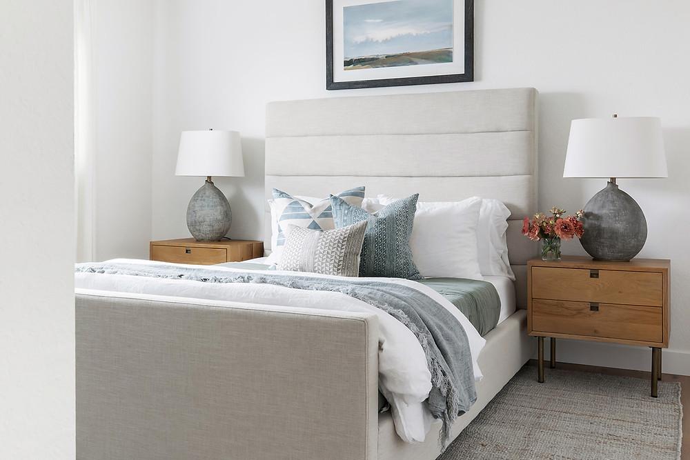 bedroom with upholstered bed by Lindsey Brooke Design