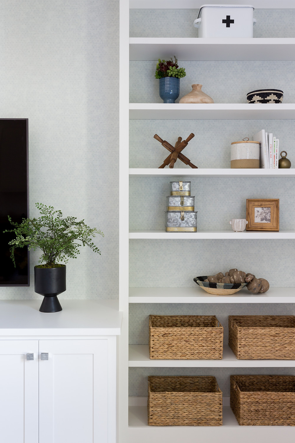 built-in shelves with wallpaper