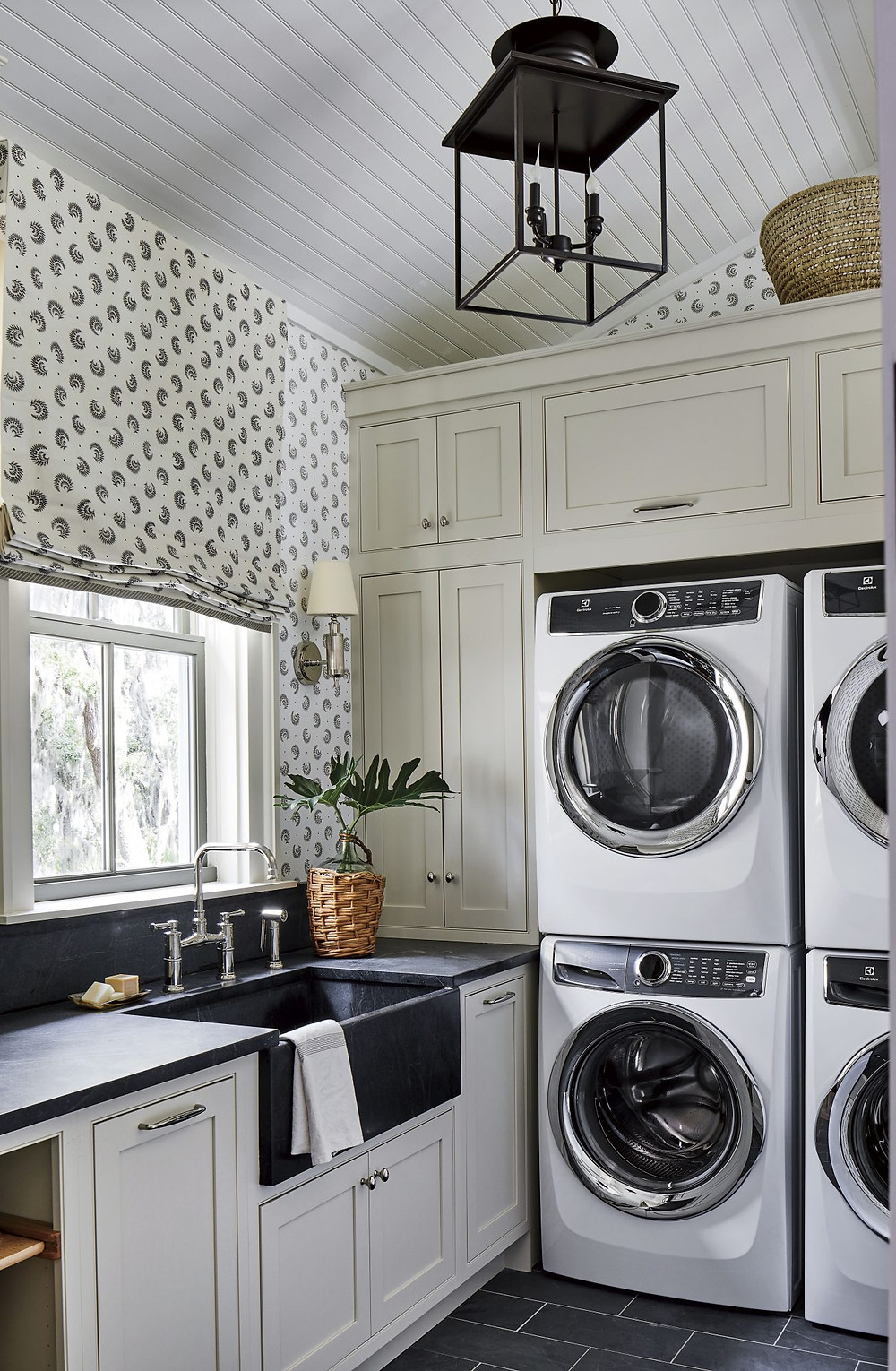 laundry room with wallpaper
