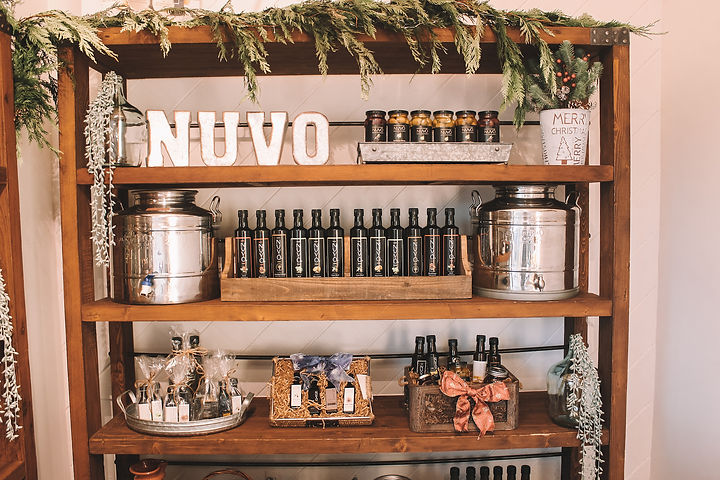 A local family owned artisanal olive oil company reached out to us about restyling their tasting room for the holidays before a community event.  The goal was to bring attention to the products while also adding some festive holiday décor to the space.  We restyled the tasting room with an organic, farm to table feeling and brought in some natural greenery and lights for a holiday flair.