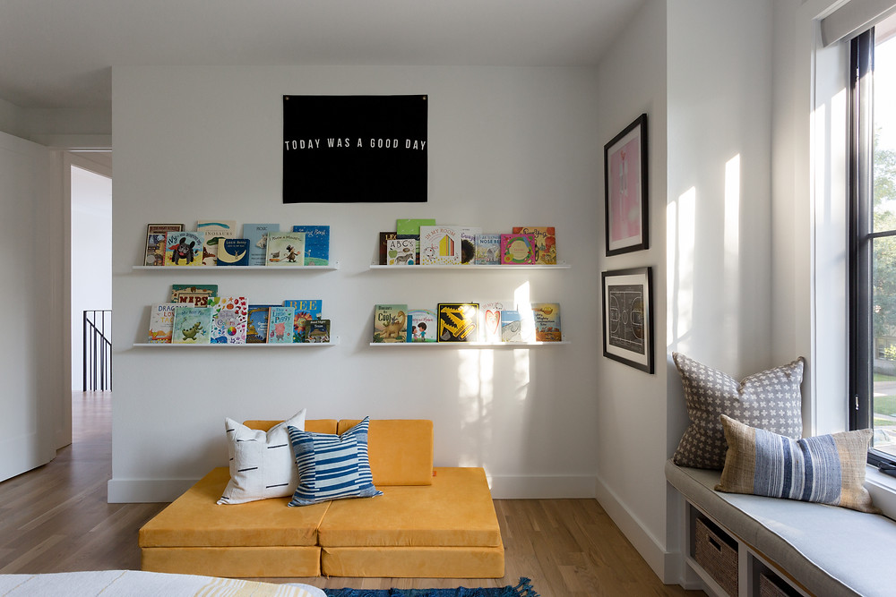 floating book ledges with yellow Nugget sofa