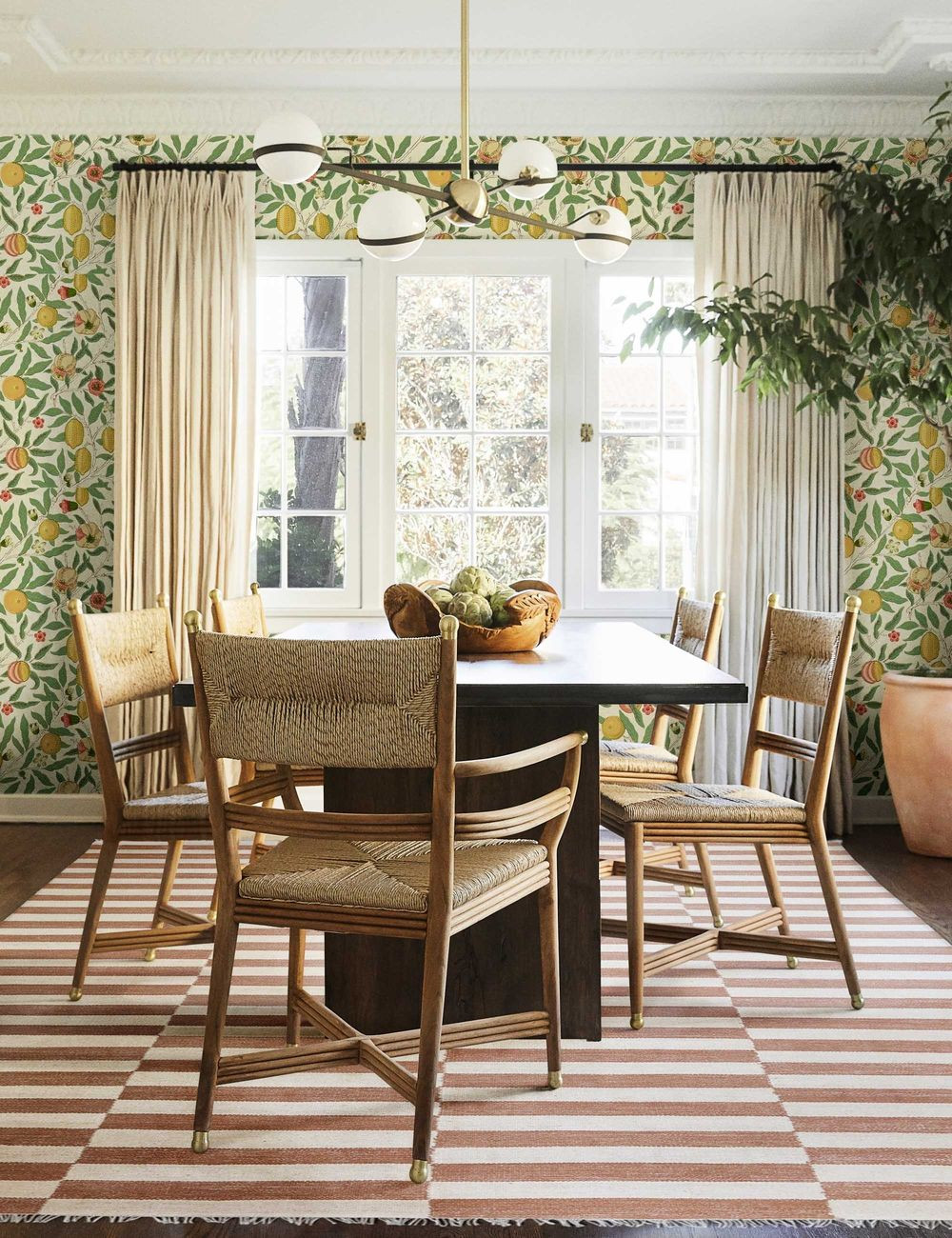 dining room with wallpaper and striped rug