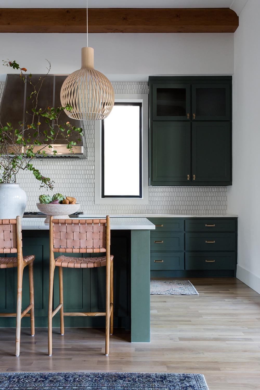 green kitchen cabinets with steel range hood