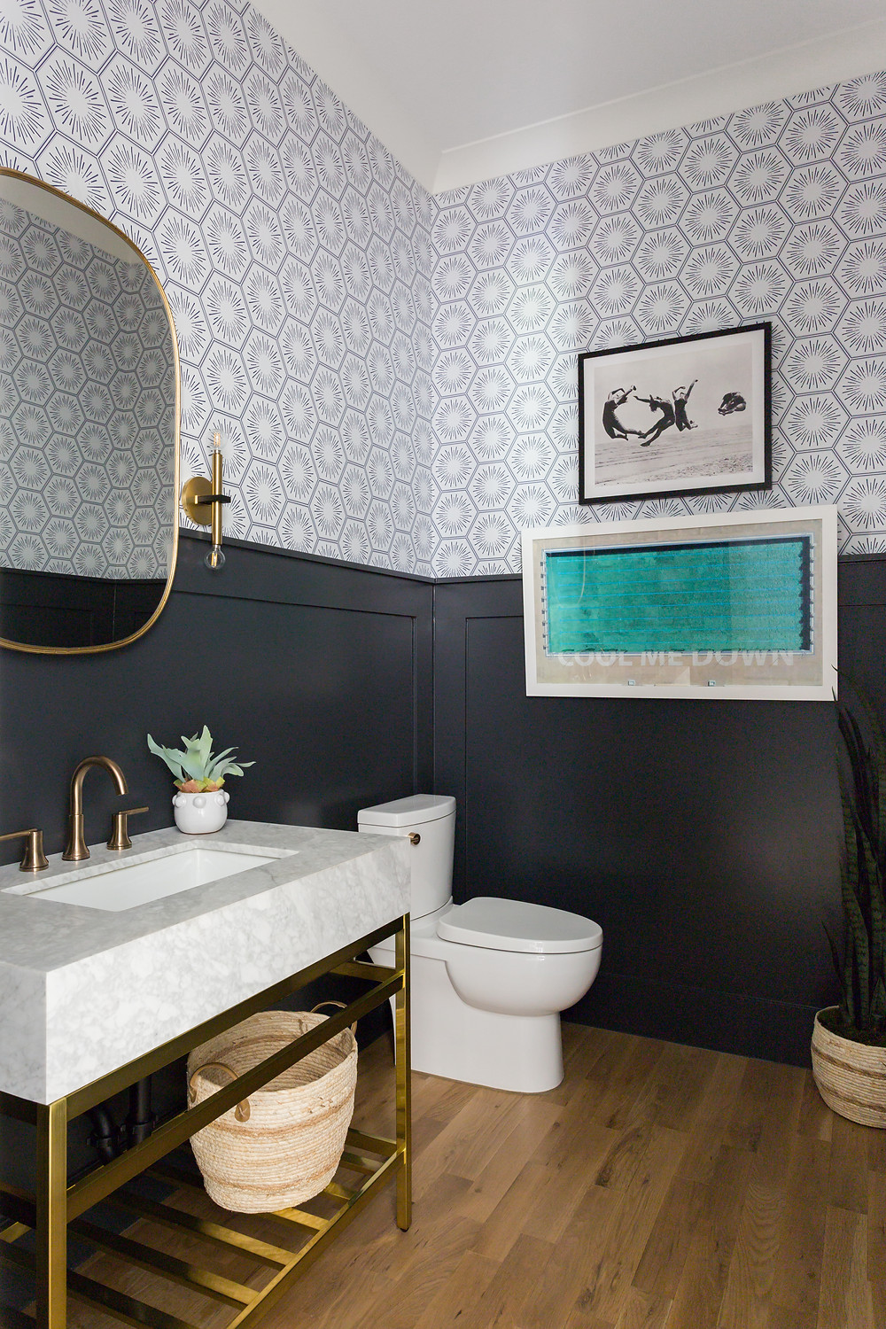powder room with dark wainscot and wallpaper