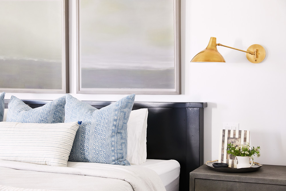 Bright and airy transitional master bedroom with pops of blue, velvet and brass fixtures. Click through for the 7th Avenue Project reveal by Phoenix based interior designer, Lexi Westergard Design.