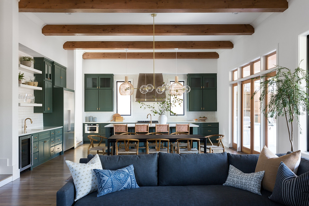 open-concept living, dining, and kitchen with green cabinets