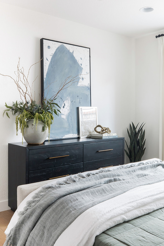 bedroom with black dresser by Lindsey Brooke Design