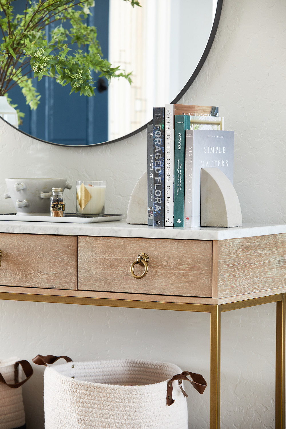 Bright and airy entryway design with wood and marble console table and round black mirror. Mountain View Project Reveal by Phoenix interior designer Lexi Westergard Design.