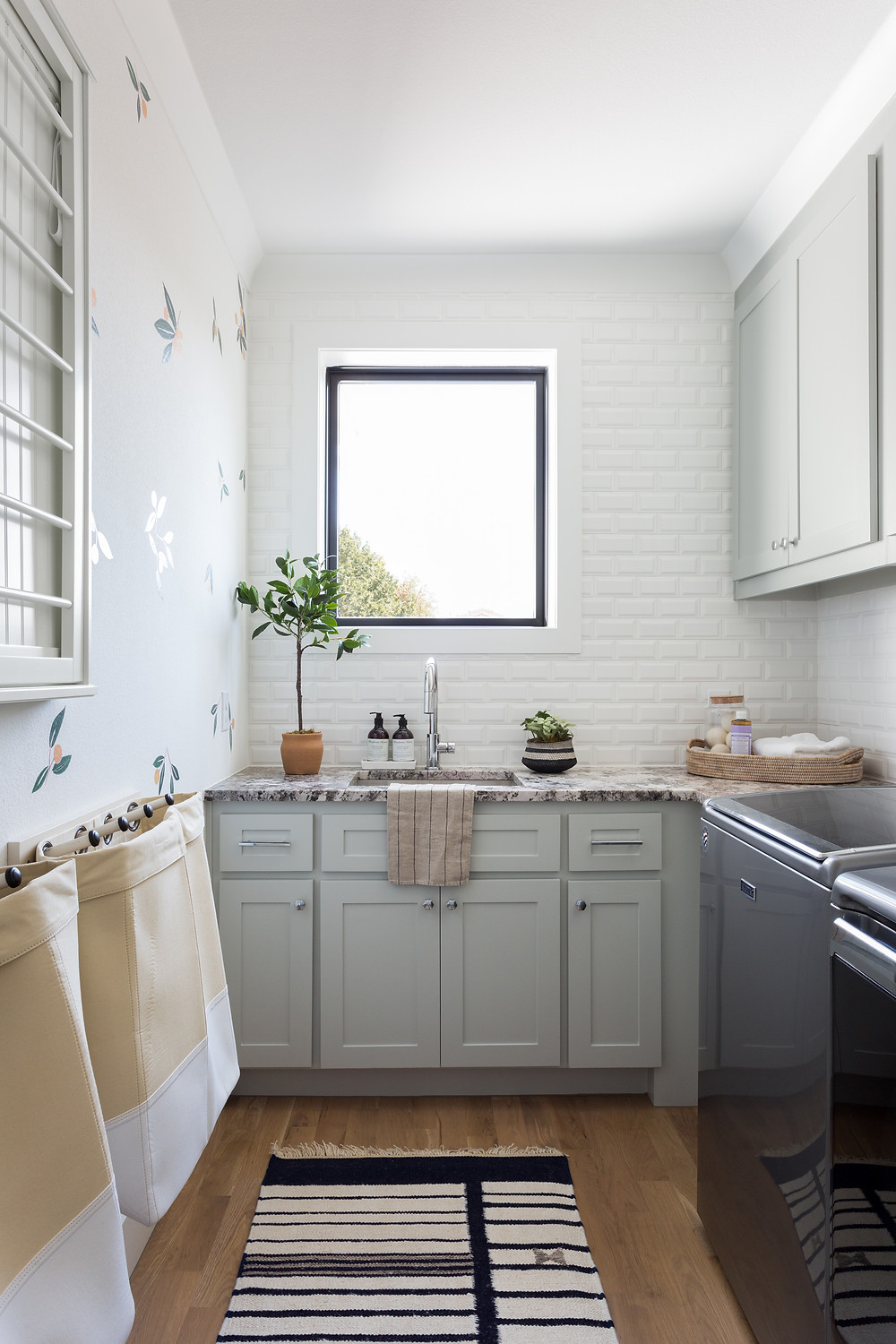 laundry room with gray cabinets