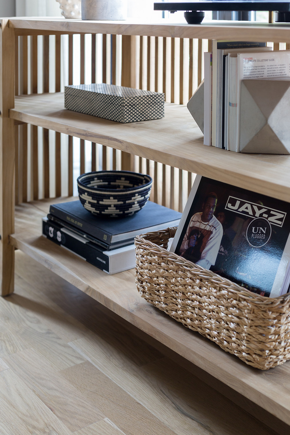 white oak shelf with books and vinyl records