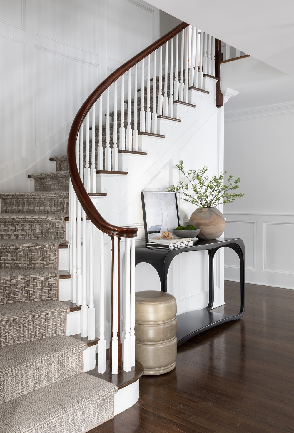 white entry hall with console table