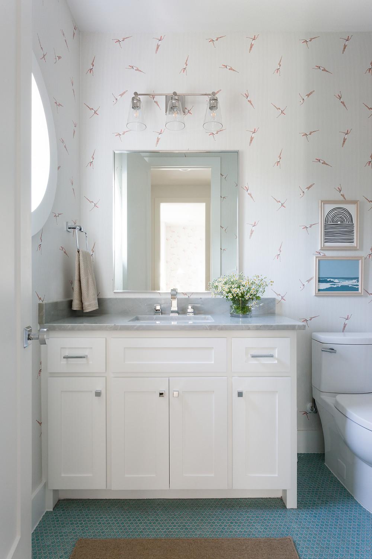bathroom with wallpaper and aqua penny tile