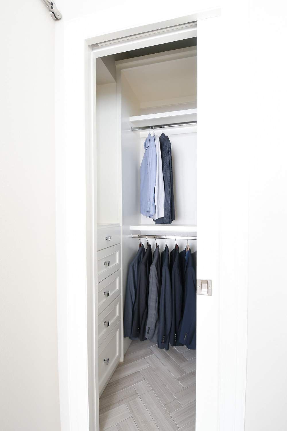 Transitional bathroom with updated closet space by Modern bedroom retreat by Houston interior design firm Nancy Lane Interiors.