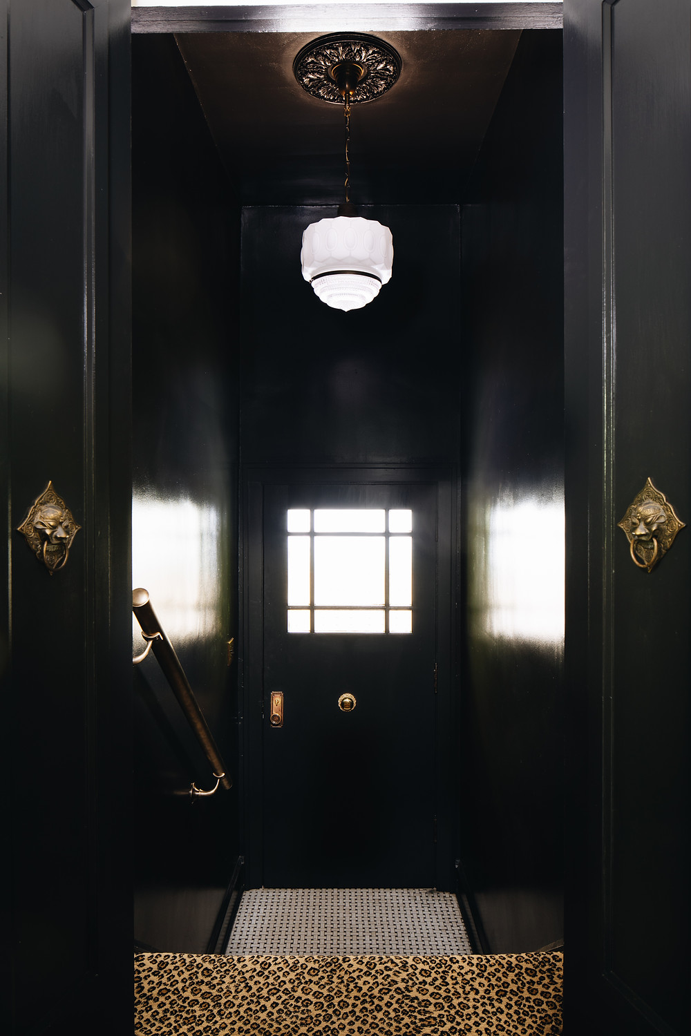 Dark and dramatic entryway by ReDesign Home
