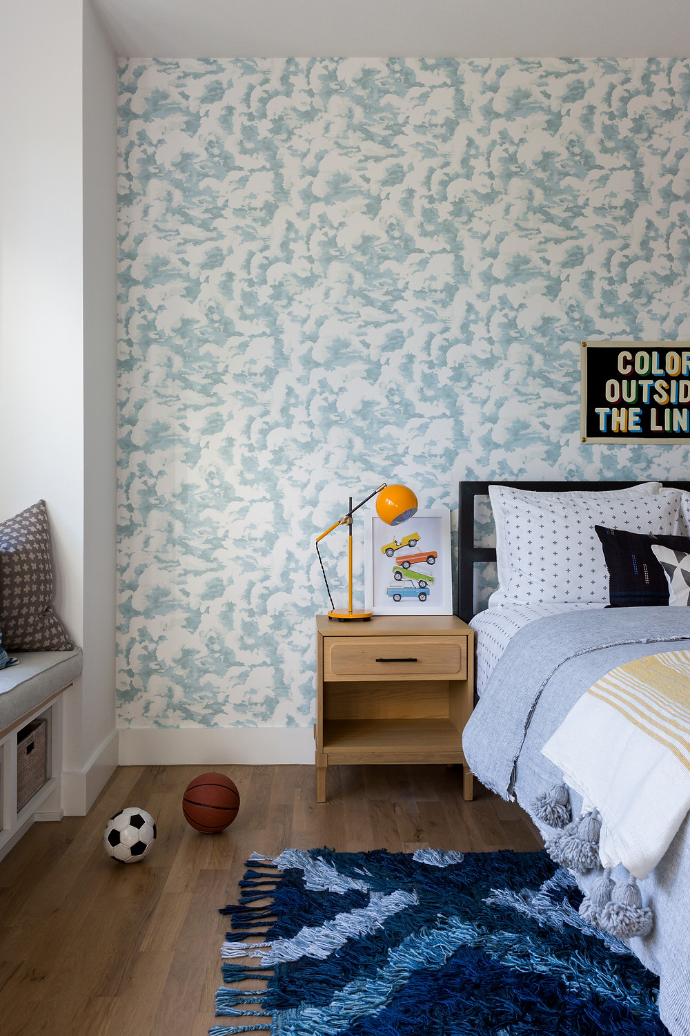 boys bedroom with blue wallpaper