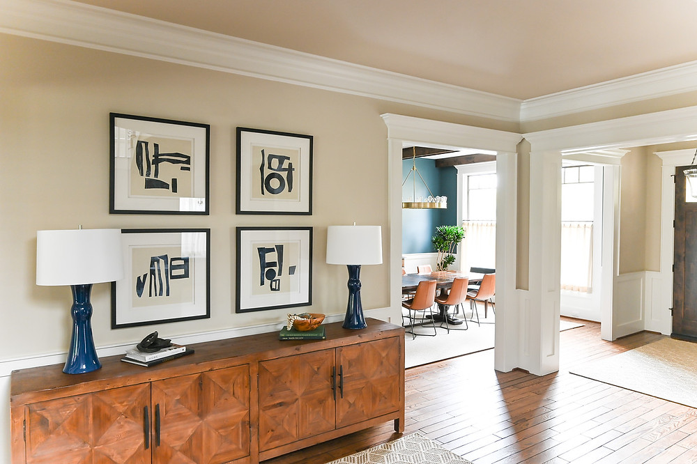 Modern transitional entryway and dining room by Houston interior design firm Nancy Lane Interiors