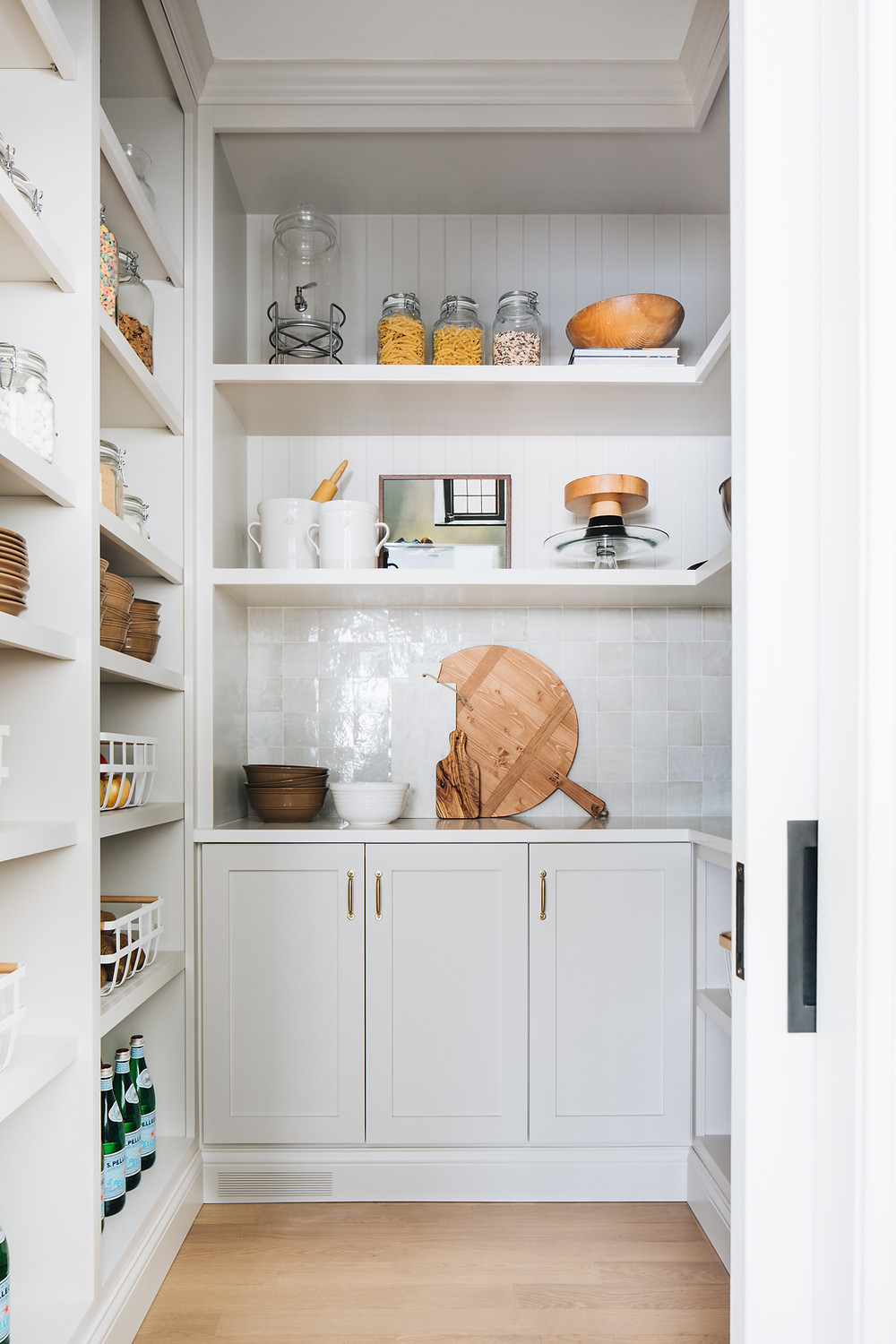 pantry with cabinets and open shelves