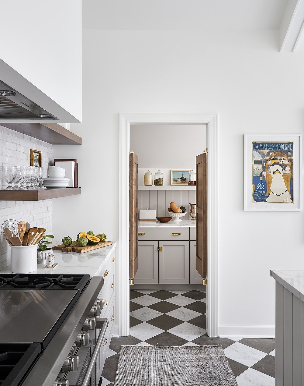 kitchen and pantry with checkerboard tile