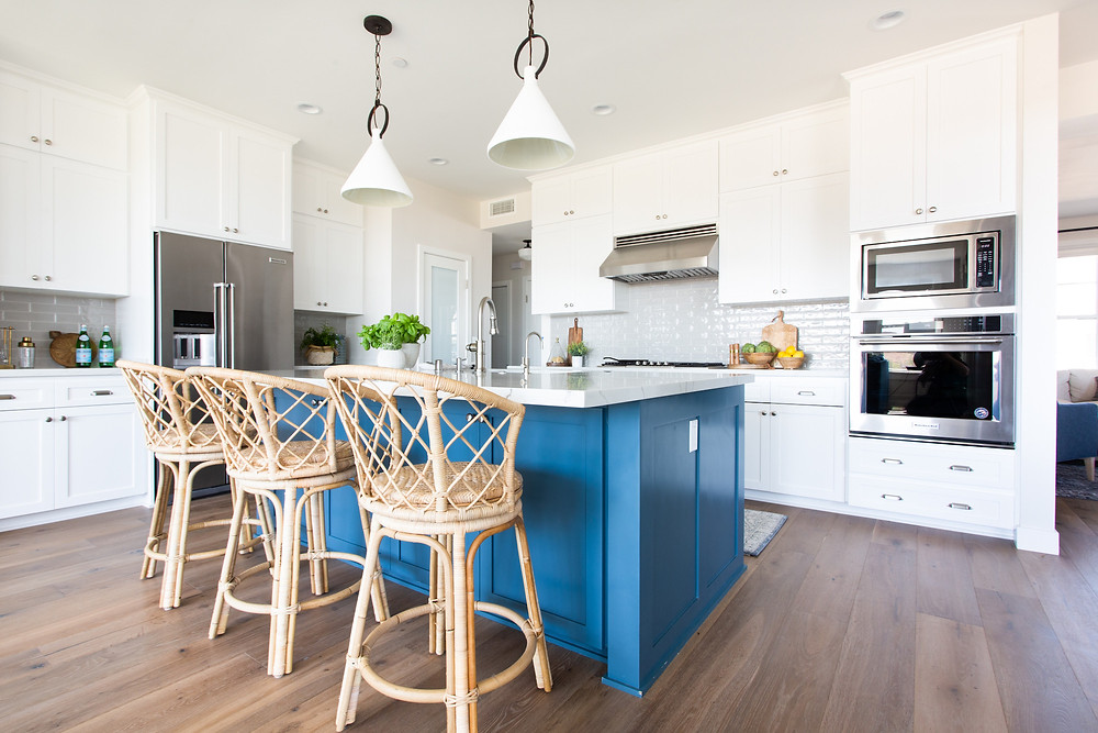 blue island kitchen with rattan bar stools