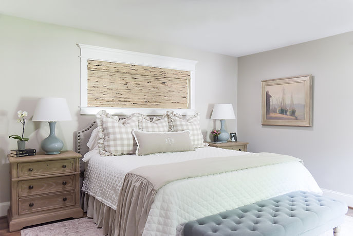 This project was a romantic bedroom for a couple with two young kids. Our task was to create a sanctuary for them to relax and unwind in after a long day with littles. The only glitch in our giddy up was the window placement which we worked around with a custom height headboard. The bed itself got the royal treatment with layered linen bedding and ruffles galore, topped off with a custom monogrammed lumbar pillow. We hung the client's cherished family artwork, all painted by her uber talented grandfather, on the walls to surround all new selections of bedroom furniture and accessories.
