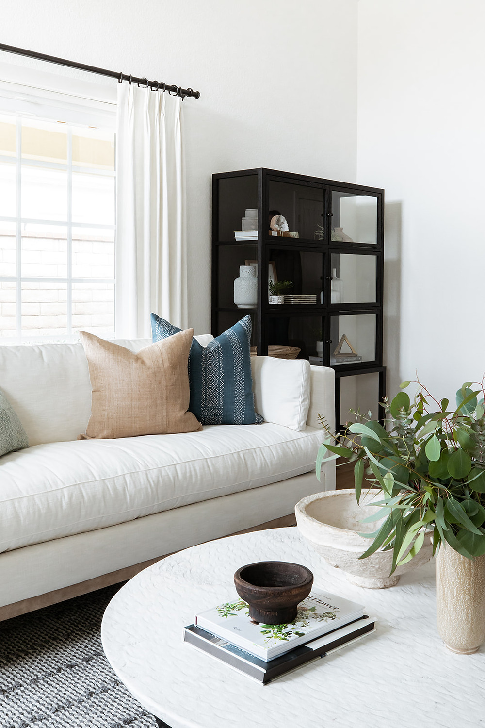 linen sofa with black cabinet