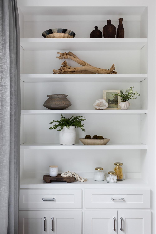 white shelf with found objects