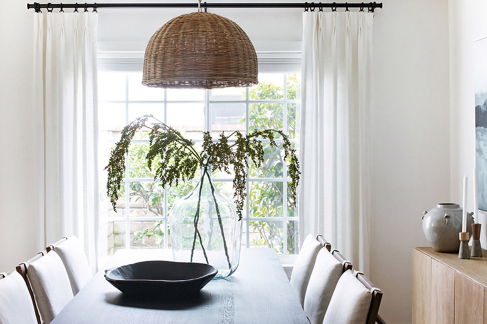 dining space with white curtains