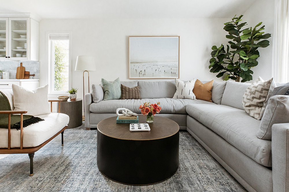 grey sectional sofa with round coffee table