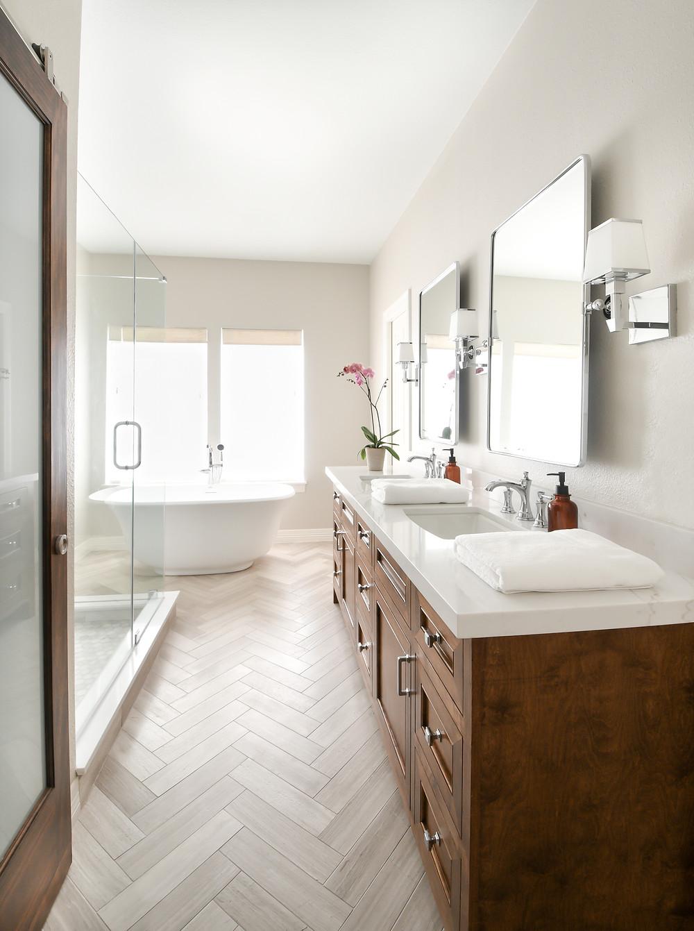 Modern transitional primary bathroom retreat by Houston interior design firm Nancy Lane Interiors.