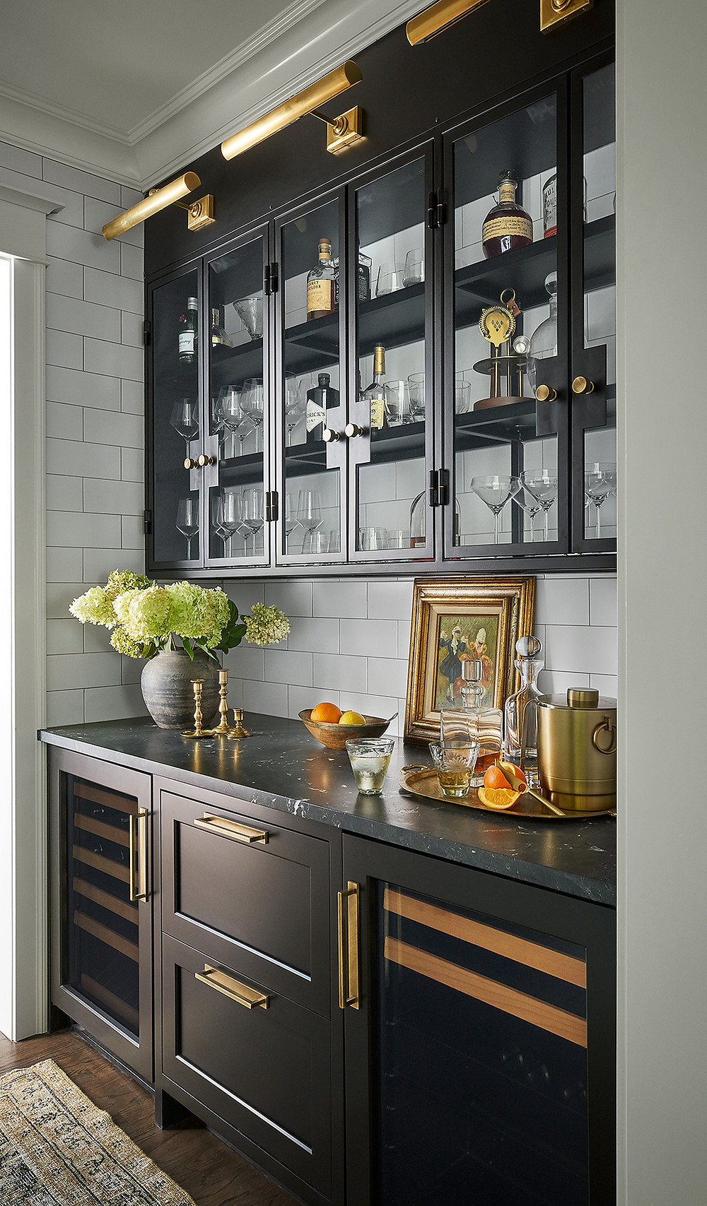 butler's pantry with dark cabinets and quartzite