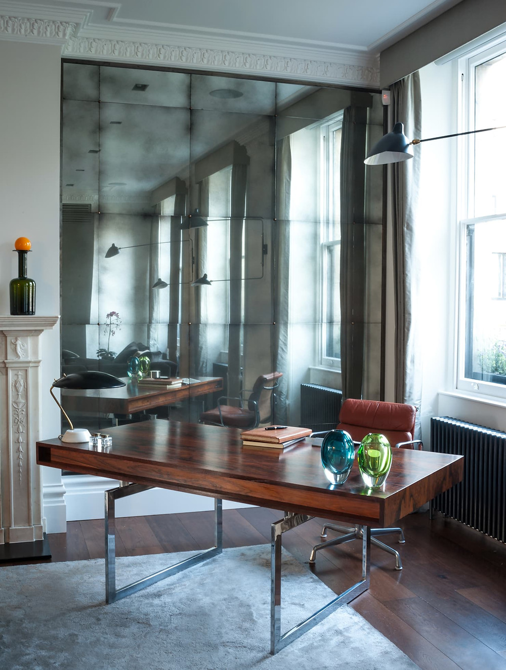 Wall clad with antique mirrors