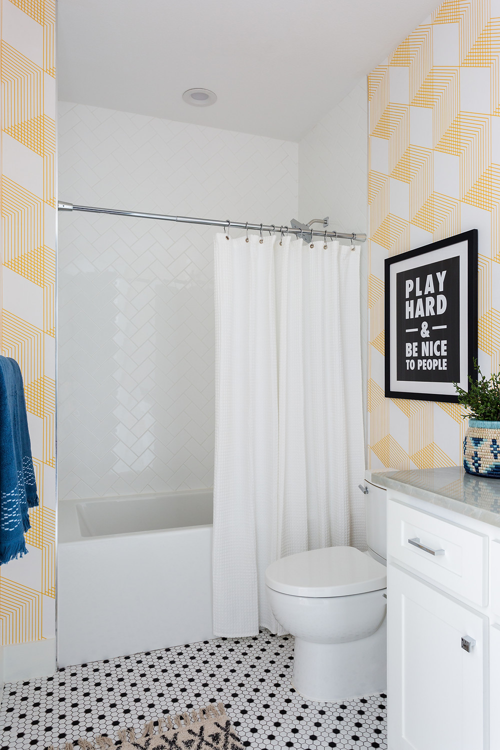 bathroom with graphic yellow wallpaper