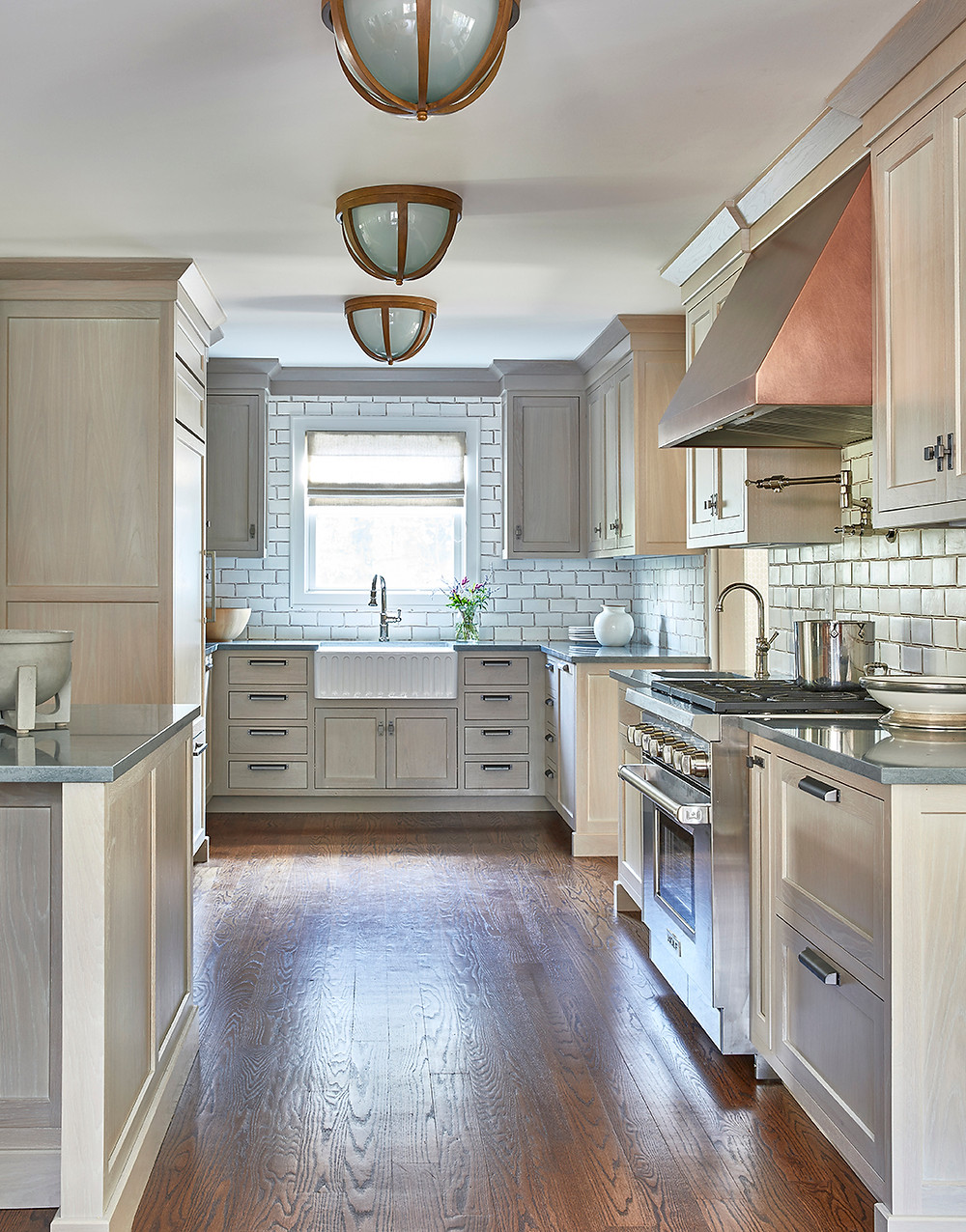 kitchen with wood cabinetry and handmade tile