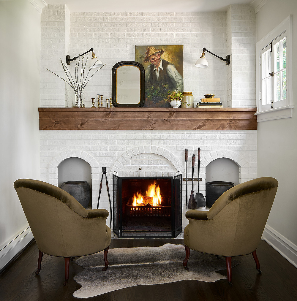 living space with fireplace and cowhide rug