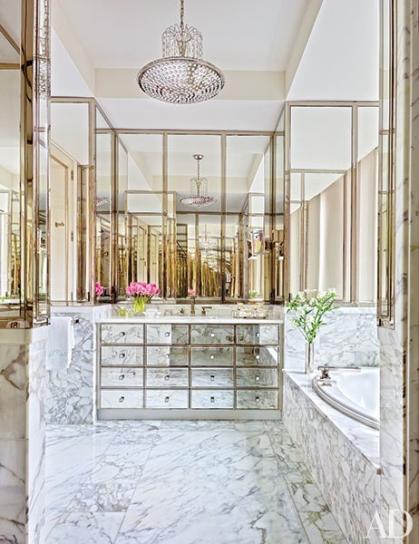 Bathroom with marble and antique mirrors
