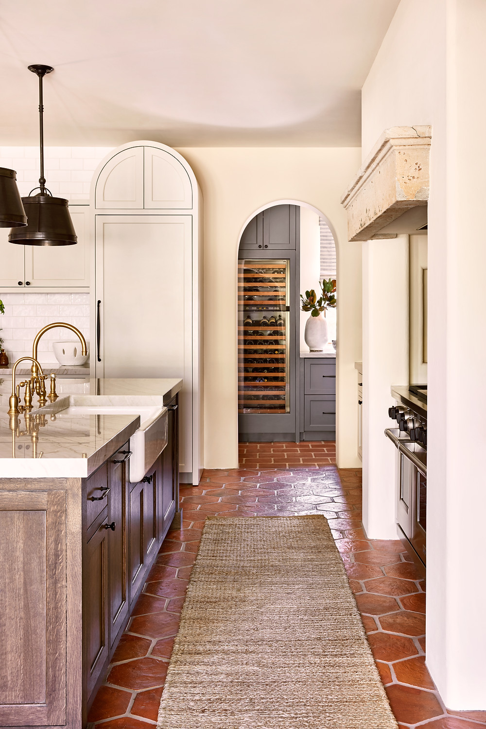 Spanish-style kitchen with wood island