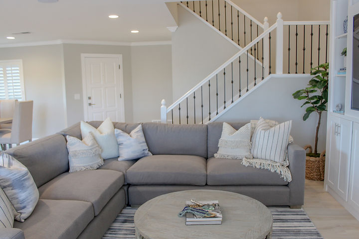 The clients purchased this home and immediately started remodeling to update the finishes to their tastes.  They wanted the furnishings to complement the lighter tones and more contemporary elements of the new space while still retaining a cozy, family feeling.