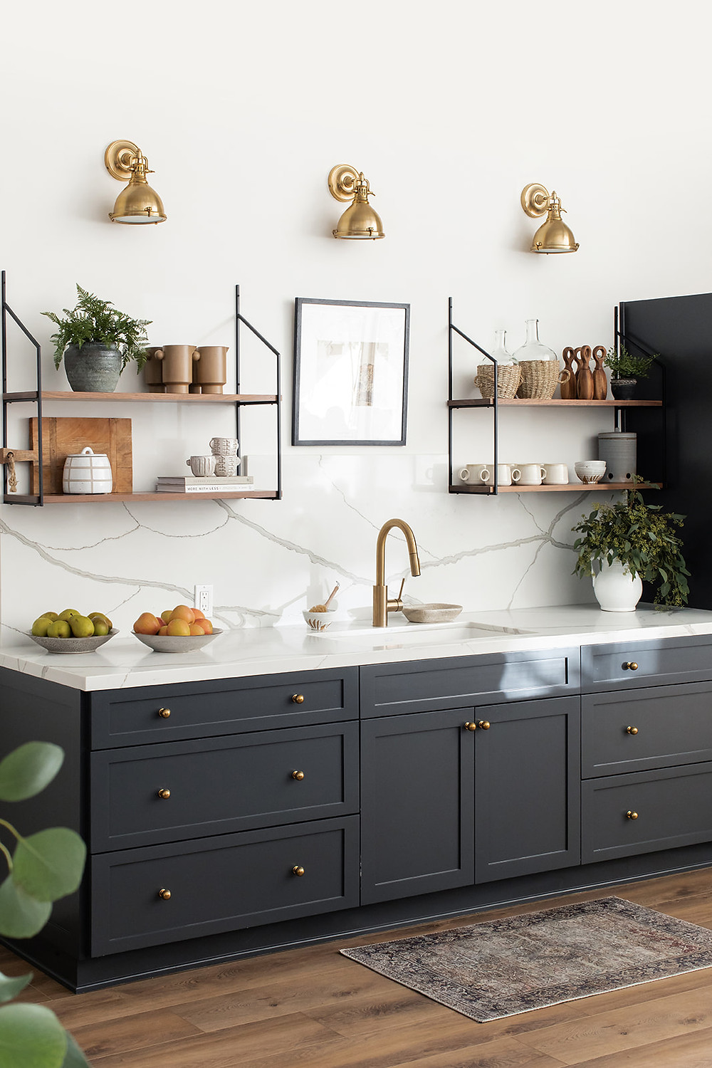 kitchenette with dark gray cabinets and quartz counters