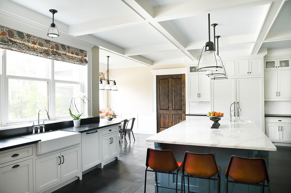 Gorgeous transitional kitchen updated by residential design firm Nancy Lane Interiors in Houston.