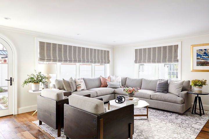 A bright and airy family room and a cozy breakfast nook reveal.