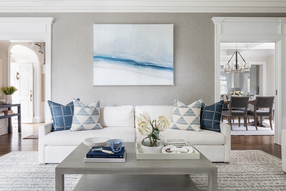 living room with white sofa and geometric pillows