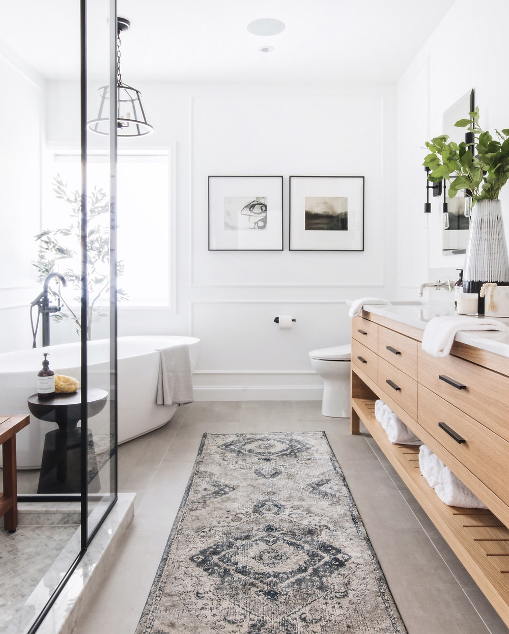A serene bathroom escape in this warm modern design by Leclair Decor. Soft whites and warm oak compliments a historic home in Westmount Montreal.