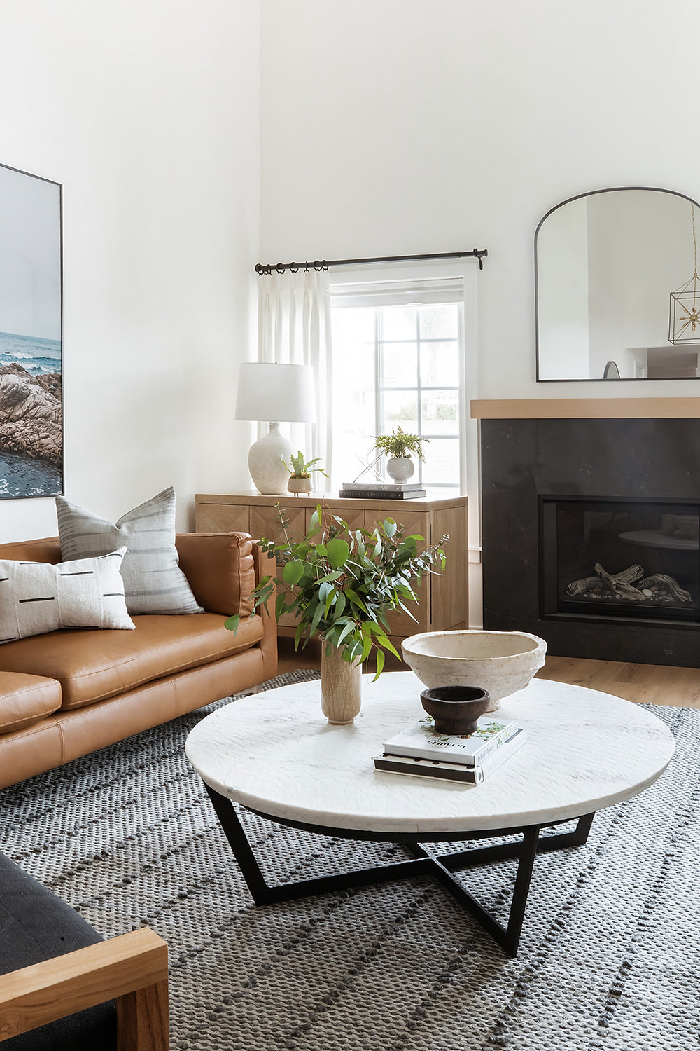 leather sofa with round marble coffee table